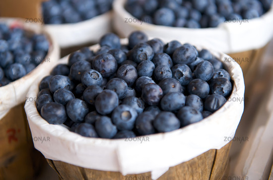 Blueberries in a basket on a market stall Blueberries in a basket on a market stall