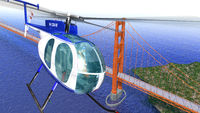 Helicopter flying over the Golden Gate bridge. Brid eye view with blue sea.