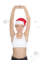 beautiful asian woman in Santa's hat engaged in fitness