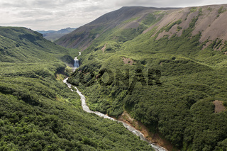 River and waterfall in the Caldera volcano Ksudach. South Kamchatka Nature Park.