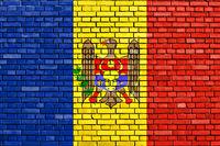 flag of Moldova painted on brick wall
