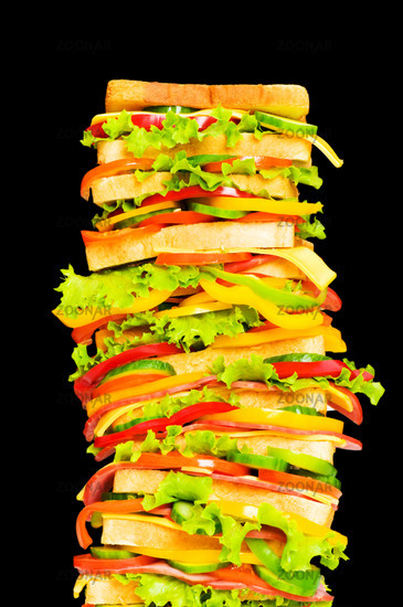 Tall sandwich isolated on the black background