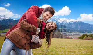 happy young couple having fun over alps mountains