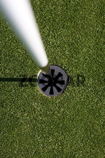 a flags eye view, of the golf hole.