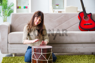 Woman playing drums at home