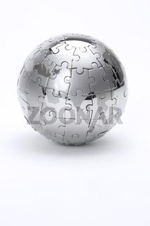 Metal puzzle globe isolated on white background