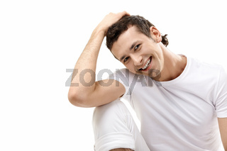 The young smiling man on a white background