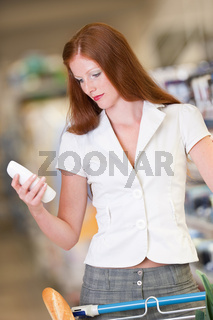 Shopping series - Red hair woman holding shampoo