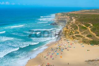 People ocean beach coastline Portugal