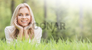 Pretty girl laying on grass