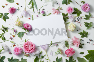 flowers with empty white notebook