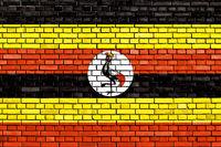 flag of Uganda painted on brick wall