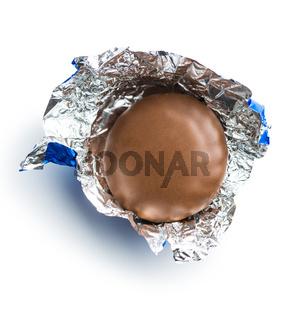 Chocolate biscuit wrapped in aluminium foil.