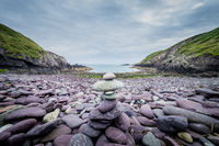 Pebbles stack on the beach on Caer Bwdy Bay in St.Davids, Wales