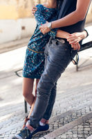 Young couple hugging outdoors in city at summer