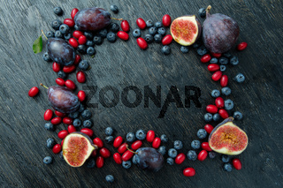 frame with berries and figs