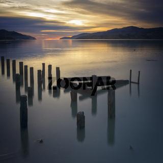 Sunrise Over Water Banks Peninsula New Zealand