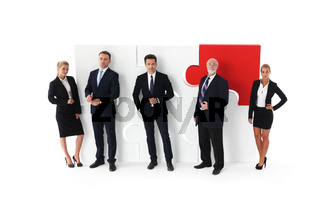 Business team and big puzzle