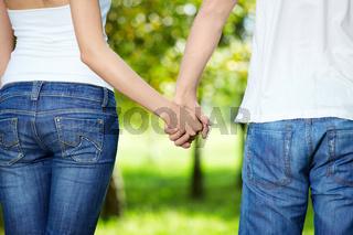 Close up behind keeping hands enamoured