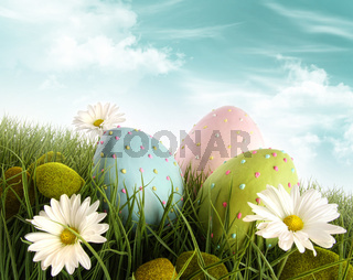 Decorated easter eggs in the grass with daisies