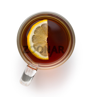Tea in glass cup with sliced lemon.