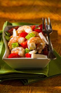 Shrimp salad over a green napkin