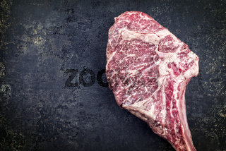 Kobe Tomahawk Steak on old Metal Sheet