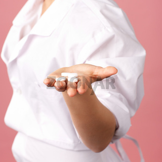 Medical pills in woman hand closeup