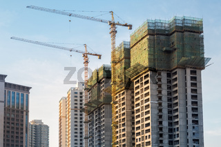 cranes at city construction site