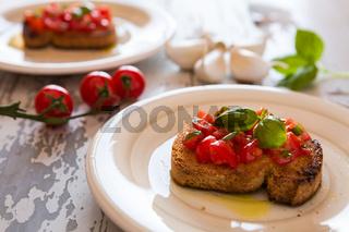 Closeup of Italian bruschetta with tomato and basil