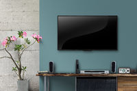 Led tv on concrete wall with wooden table in livingroom