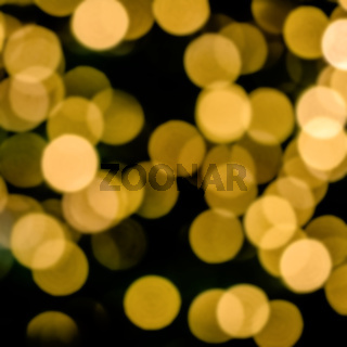 Bokeh of blurred electric candles on a christmas tree