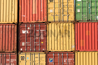 Kristiansand, Norway, November 5, 2017: Stack of containers in yellow, red, green and orange