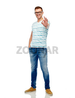 young man in eyeglasses showing ok hand sign