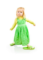 Beautiful little girl with big slippers