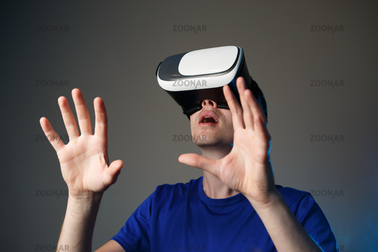 Young man using a VR googles.