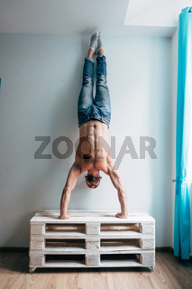 Man posing on camera, standing upside down