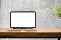 laptop on wooden desk