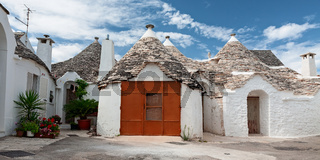 Some Trulli houses in a street of Alberobello, Puglia, Italy