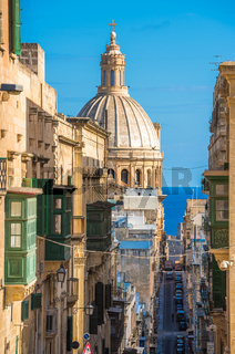 Street of Valletta with traditional balconies, Malta