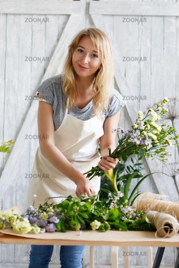 Florist blonde in flower shop
