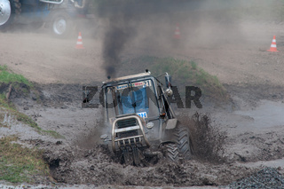 Race of tractors in the mud, Rostov-on-Don, Russia, July 5, 2016, Beezotrek show