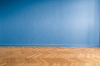 blue wall background  in empty room  with parquet floor -