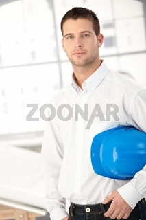 Young engineer standing in bright office