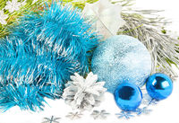 New year and Christmas composition with blue tinsel, fir tree on white background