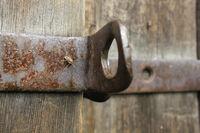 Old wooden door with rusty screw 20555