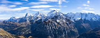 snow scene on alpes mountains in cloud sky