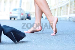 female bare feet dancing on summer street
