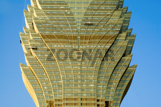 The facade of lotus shaped golden skyscraper over sky