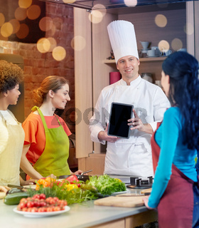 happy women with chef and tablet pc in kitchen